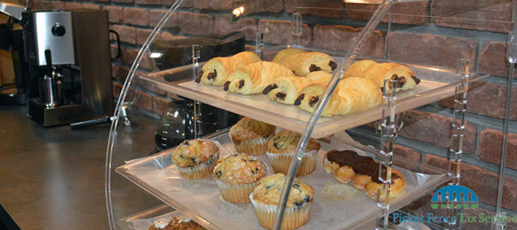 Our stress-free local income tax preparation experience includes a beverage and pastry